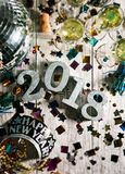 New Year: Looking Down At Party Table For NYE. A series celebrating New Year`s Eve, some with 2018 numerals.  Lots of confetti, champagne, etc. Good for Stock Images