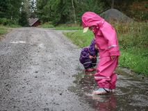 Children play and jumping in muddy puddle. Series of children play and jumping in muddy puddle stock images