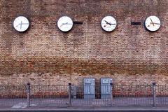 A series of clocks registering the times in major cities Royalty Free Stock Images