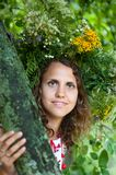 Series of closeup portrait of a beautiful girl. In a field with a wreath stock image