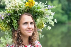 Series of closeup portrait of a beautiful girl. In a field with a wreath stock images
