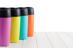 Series of color thermos mugs Royalty Free Stock Photography