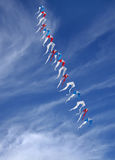 Series of colorful kites in clear sky Royalty Free Stock Image