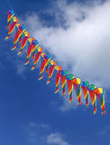 Series of conical colorful kites in clear sky Royalty Free Stock Images