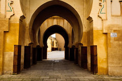 Series curving arches of passageway into courtyard Royalty Free Stock Image