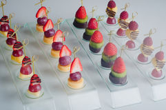 Series of dessert canape from fruits on the table Stock Photography