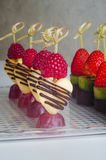 Series of dessert canape from fruits on the table Royalty Free Stock Photos