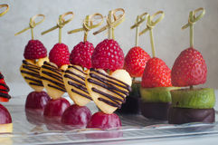 Series of dessert canape from fruits on the table Stock Images