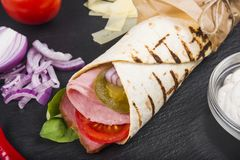 Burito with ham, tomatoes and jalapeno pepper. A series of different types of Burrito for menus photographed from one angle royalty free stock photography