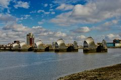 The river Thames and the thames barriers. A series of flood barriers across the river thames is an iconic landmark in London stock photos