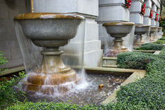 Series of fountains with running water Royalty Free Stock Image