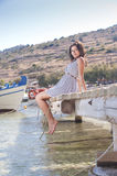 Series of a girl on the pier. Series of pictures of a beautiful girl on the pier in Zakynthos royalty free stock photography