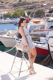 Series of a girl on the pier. Series of pictures of a beautiful girl on the pier in Zakynthos - Greece stock image