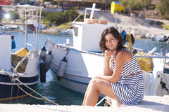 Series of a girl on the pier. Series of pictures of a beautiful girl on the pier in Greece royalty free stock images