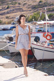 Series of a girl on the pier. Series of pictures of a girl in port - Greece royalty free stock photography