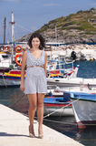 Series of a girl on the pier. Series of pictures of a girl walking in port in Zakynthos - Greece royalty free stock images