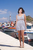 Series of a girl on the pier. Series of pictures of a girl watching at camera in Zakynthos - Greece stock photos