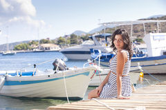 Series of a girl on the pier. Series of pictures of a girl watching at camera on pier in Zakynthos - Greece royalty free stock photos