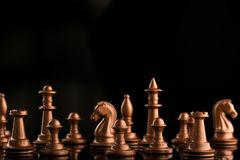 gold chess pieces on a black glossy Royalty Free Stock Images