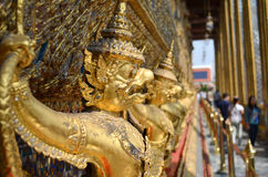 Series of golden statues lined up Royalty Free Stock Images
