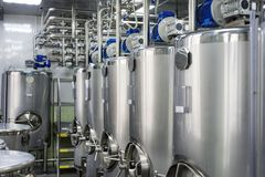 A series of gray metal tanks for mixing liquids. stock photo