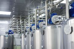 A series of gray metal tanks for mixing liquids. stock photos