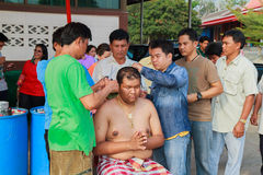 A series of initiation rites that have changed to the new man at the temple Thailand. Bangkok March 1: a series of initiation rites that have changed to the new Stock Photography
