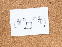 The series of Japanese emoticons called Kaomoji, surprised. The series of Japanese emoticons called Kaomoji on the cork board, surprise Royalty Free Stock Image