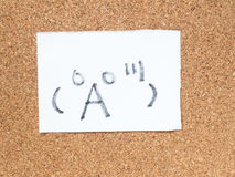 The series of Japanese emoticons called Kaomoji, surprised. The series of Japanese emoticons called Kaomoji on the cork board, surprise Stock Photos