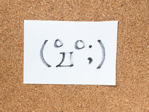 The series of Japanese emoticons called Kaomoji, surprised. The series of Japanese emoticons called Kaomoji on the cork board, surprise Stock Photography