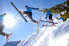 Series of a jumping skier in backlight Royalty Free Stock Photos