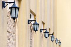 Series of lanterns on a yellow wall, Dubai Stock Images