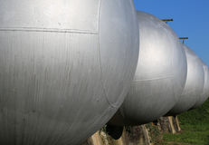 Series of large pressure tanks for the storage of natural gas. In case of rationing of energy resources Royalty Free Stock Images