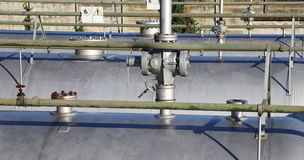 Series of large pressure tanks for the storage of natural gas in. Valve in the series of large pressure tanks for the storage of natural gas in case of rationing Stock Photos