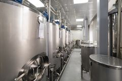 Series Large steel tanks for mixing liquids, modern production of alcoholic beverages. Food industry stock images