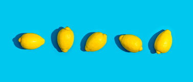 Series of lemons. On a blue background Stock Photography