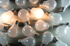 Series of lightbulbs. On metal desk Royalty Free Stock Image