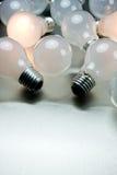 Series of lightbulbs. On metal desk Royalty Free Stock Photo