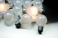 Series of lightbulbs. On metal desk Stock Photography