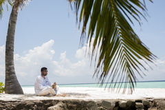 Series of Maldives. Series in Maldive,man with coconut royalty free stock photo