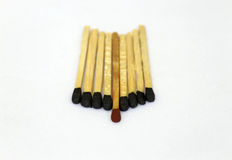 Series of Match stick with red head in middle Royalty Free Stock Photo
