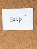 The series of a message on the cork board, sup. The series of a message on a piece of paper on the cork board, sup royalty free stock images