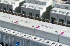 A series of modular magnetic contactors and a range of power circuit breakers. Royalty Free Stock Photo
