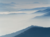 Series of mountain's and hill's profiles surrounded by autumn mi Stock Photography