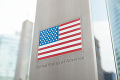 Series of national flags on pole - USA Stock Image