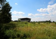 Unfinished stadium in the field in Monino. Series `Nature and Life of Russia.` Moscow regions. Summer of 2017 Stock Photography