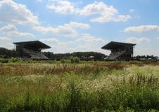 Unfinished stadium in the field in Monino. Series `Nature and Life of Russia.` Moscow regions. Summer of 2017 Royalty Free Stock Images