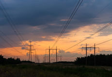 Free Series Of Power Lines On The Background Of Orange Sunset Stock Image - 75414151