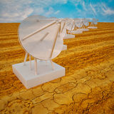 Series of parabolic antennas under blue sky Royalty Free Stock Photos
