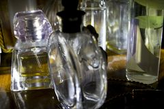 Perfume bottles illumined from lateral light. Series of perfume bottles illumined from directional light Royalty Free Stock Image
